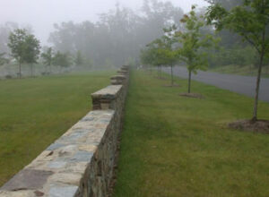 Stone Crafted Wall in the Garden on a Foggy Day